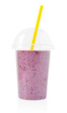 Blackberry smoothie in plastic transparent cup Royalty Free Stock Images
