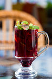 Blackberry tea in a glass cup. Decorated with mint leaves Stock Images