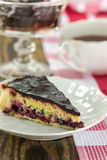 Blackberry vanilla custard tart. Slice of blackberry vanilla custard tart on rustic background Stock Photography