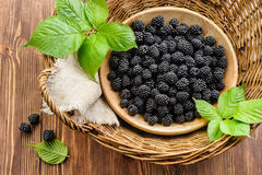 Blackberry in wooden bowl in basket Royalty Free Stock Photography