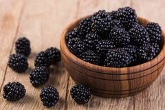 Blackberry. On a wooden table Stock Photo