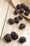 Blackberry on a wooden table Stock Images