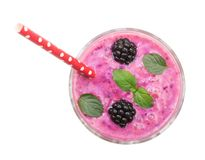 Blackberry yogurt or smoothie with mint leaves isolated on white background. Top view. Healthy Eating royalty free stock photo