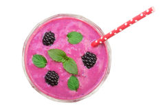 Blackberry yogurt or smoothie with mint leaves isolated on white background. Top view. Healthy Eating stock images