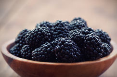 Blackberrys. Ripe blackberrys in a wooden bowl Royalty Free Stock Photography
