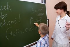 By the blackboard Royalty Free Stock Image