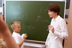 By the blackboard Stock Photos