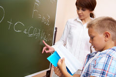 By the blackboard Royalty Free Stock Photo