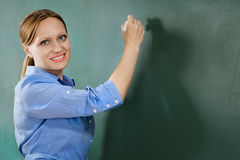 At the blackboard Stock Photography