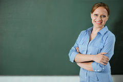 At the blackboard Stock Images