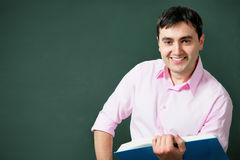 At the blackboard. Attractive teacher or student at the blackboard Royalty Free Stock Photography
