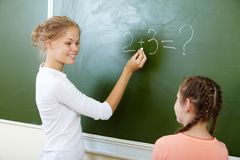 By the blackboard Royalty Free Stock Images
