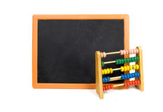 Blackboard with abacus Stock Photography