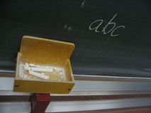 Blackboard ABC. Blackboard with ABC written on it and a pile of chalks Royalty Free Stock Photography