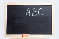 Blackboard with the alphabet Stock Images