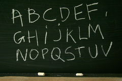 Blackboard alphabet. Writing the alphabet on a blackboard Royalty Free Stock Photo