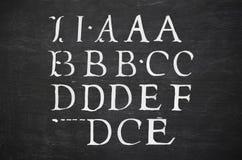 Blackboard with alphabet Stock Image