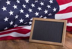 Blackboard and American Flag Royalty Free Stock Photos
