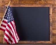 Blackboard and American Flag royalty free stock image