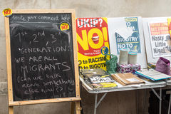 Blackboard at an Anti UKIP stall. Blackboard with message about immigration at an Anti UKIP and Farage stall Royalty Free Stock Photos