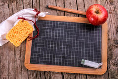 Blackboard with apple and sponge Royalty Free Stock Photo