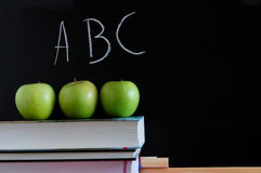 Blackboard and apples Stock Photos