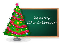 A blackboard at the back of a christmas tree Royalty Free Stock Images