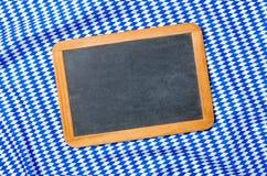 A blackboard on a bavarian diamond pattern Royalty Free Stock Photography