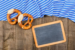 Blackboard with a bavarian diamond pattern and pretzels Royalty Free Stock Image