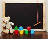 Blackboard with bear and blocks Royalty Free Stock Photography