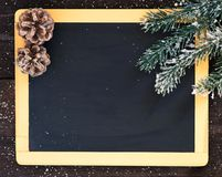 Blackboard blank with christmas decoration. Board decorated with fir branch and snowflakes Royalty Free Stock Images