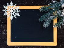 Blackboard blank with christmas decoration. Blackboard blank decorated with fir branch and snowflake Stock Images