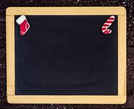 Blackboard blank with christmas decoration. Christmas tree decorations border on  wooden blackboard Royalty Free Stock Photography