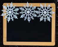 Blackboard blank decorated with snowflakes. Blackboard blank decorated with snowflake Stock Photo