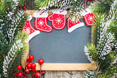 Blackboard blank framed in beautiful Christmas tree branches and Stock Photography