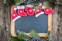 Blackboard blank framed in beautiful Christmas tree branches and Royalty Free Stock Images