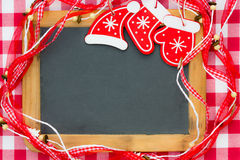 Blackboard blank framed in red Christmas decorations Royalty Free Stock Photos