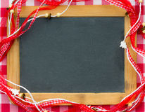 Blackboard blank framed in red Christmas decorations Royalty Free Stock Images