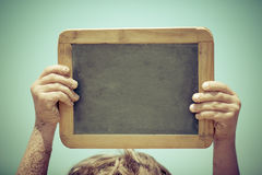 Blackboard blank in hands Royalty Free Stock Photos