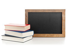 Blackboard with books Stock Images