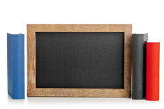 Blackboard with books Royalty Free Stock Image