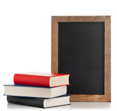 Blackboard with books Royalty Free Stock Photos