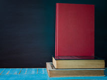 Blackboard and Books. with free space for text. Blackboard, books and watches, on the table in the classroom. with free space for text Stock Photography