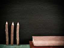 Blackboard, books and pencils. with free space for text  sele. Blackboard, books and pencils , on the table in the classroom. with free space for text  select Stock Image