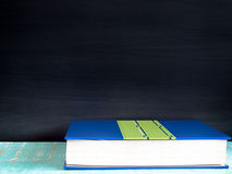 Blackboard and books. Blackboard, books , on the table in the classroom Royalty Free Stock Images