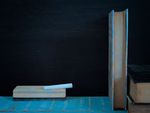 Blackboard and books. Blackboard and books, on the table in the classroom.  vintage Royalty Free Stock Photos