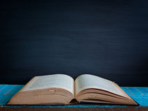 Blackboard and  books. vintage. Blackboard and  books , on the table in the classroom. vintage Royalty Free Stock Image