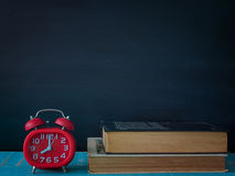 Blackboard, books and watches. Blackboard, books and watches, on the table in the classroom Royalty Free Stock Images