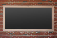 Blackboard on brick wall Stock Photo