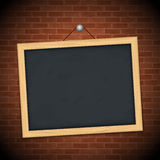 Blackboard on brick wall Royalty Free Stock Photos